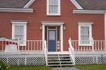 The facade of the John William Roberts House situated on historic property in Woody Point in Gros Morne National Park in Newfoundland, Canada.