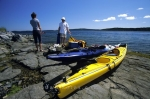 Two tourists seeking adventure: Kayaking near St Anthony, Newfoundland, Canada, North America.