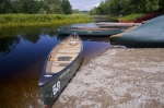 Canoe rentals for visitors to Kejimkujik National Park in Nova Scotia, Canada are available along the banks of the Mersey River.