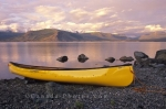 A sunset over Kluane Lake in the Yukon Territory in Canada is the perfect time to pull your canoe up onto the beach and enjoy the scenery and tranquility of the area.