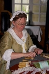This picture shows a woman making lace at the De Gannes House (Military Captain) at the Fortress of Louisbourg in Cape Breton, Nova Scotia.