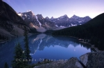 Mountain Peaks surround Lake Moraine in the Rocky Mountains of Alberta.