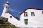 Dating back to 1892, this heritage building was once home to the lighthouse keepers who kept the Lobster Cove Lighthouse working for mariners traveling the waters of Newfoundland, Canada near Rocky Harbour and Bonne Bay.