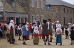 Costumed dancers outside the Innkeepers Home in the Quay at the Fortress of Louisbourg in Cape Breton, Nova Scotia.