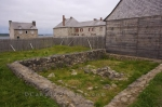 Behind the fence at the Fortress of Louisbourg in Cape Breton, Nova Scotia, lays the remains of the house that Joseph Dugas resided in.