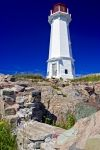 The white structure with the red lantern that adorns the entrance to the Louisbourg Harbour in Cape Breton, Nova Scotia is known as the Louisbourg Light.