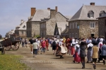 Crowds of people wander around the Quay at the Fortress of Louisbourg in Cape Breton, Nova Scotia in Canada.