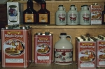 Maple Syrup in various size containers line the shelves at the Maple Sugar House Museum in Sundridge, Ontario in Canada.
