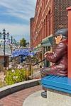 The artwork of this man is displayed outside the Market Square in the downtown area of Saint John, New Brunswick in Canada.