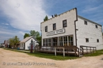 The row of historic buildings along the dirt street at the Mennonite Heritage Village in Steinbach, Manitoba begins with the General Store.