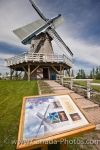 The latest replica of the windmill and the sign at the Mennonite Heritage Village in Steinbach, Manitoba. This windmill is one of the attractions to see while reliving the ways of the Mennonite people dating back to the 16th century.
