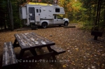 The Hicker camper parked at at one of the many sites at the Mistagance Campground at La Mauricie Natioinal Park in Quebec, Canada.