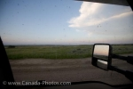 Looking out a truck window while stopped on a gravel road along the Frenchman River Valley Ecotour in Grasslands National Park in Saskatchewan, Canada, hundreds of mosquitoes can be seen.