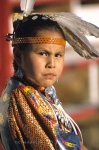A cute Native Indian girl is adorned in her authentic costume at the Siksika Fair in Alberta, Canada.
