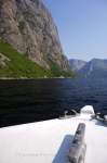 The landscape scenery adorning the lake of Western Brook Pond in Gros Morne National Park in Newfoundland, Canada.