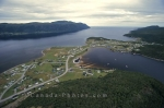 An aerial view of a small town situated along the water's edge in Gros Morne National Park in Newfoundland, Canada.