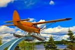 In the town of Red Lake, a Norseman aircraft is displayed on a pedestal at the Norseman Heritage Centre Park.