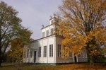 Autumn leaves surround the Sharon Temple in Ontario, Canada, a National Historic Site that welcomes visitors.