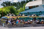 Many people stop to enjoy a meal and a refreshment on the outdoor terrace of a cafe at The Forks Market in the City of Winnipeg in Manitoba, Canada.