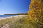 The Autumn colors highlight the trees along the beach at Pancake Bay in Pancake Bay Provincial Park in Ontario, Canada.