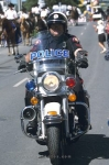 A police officer on his motorbike starts off the Calgary Stampede Parade in Calgary, Alberta.