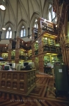High shelves filled with books line the outside walls inside the old library at the Parliament Building in Ottawa, Ontario.