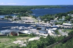 An aerial view of the buildings, boats and docks that line the waterfront of Parry Sound, part of the 30,000 Islands in Ontario, Canada.