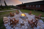 A fire glows in the centre of the pit on the patio at the Rifflin'Hitch Lodge in Newfoundland Labrador in Canada.
