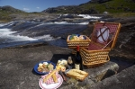 Atop the Mealy Mountains in Southern Labrador, Canada, meals are important and what better way to enjoy lunch than to sit beside a waterfall with a picnic basket full of food.