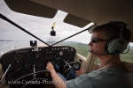 The pilot is Guy Cannon and he is flying a Cessna over Thunder Bay.