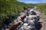While traveling along the Labrador Coastal Drive in Southern Labrador, Canada, the scenery is beautiful where you can look out over the Pinware River gorge and the fury of the rapids.