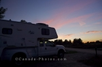 As a sunset highlights the sky over Outaouais, Quebec in Canada, we can relax and enjoy the scenery from our site at the Parc de la Plaisance campground.