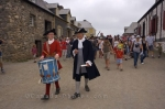 Two costumed interpreters lead the way through the streets at the Fortress of Louisbourg National Historic Site in Cape Breton, Nova Scotia on the way to a public punishment.