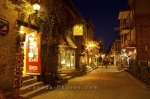The night time glow illuminating the heritage buildings in Quartier Petit Champlain in Old Quebec, Canada. This quaint area is ideal for shopping during the day/night and a beautiful place for elegant dining.