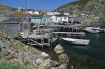 Fishing stages and homes line the harbour of Quidi Vidi, a small fishing village outside of St. John's, Newfoundland in Canada.