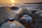 Green Point in Gros Morne National Park in Newfoundland, Canada is a great location to watch a sunset and snap a picture with the light changing the sky, beach and a glass of red wine.