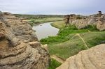 Amongst the Hoodoos in Writing on Stone Provincial Park in Southern Alberta, a raft floats down the Milk River.