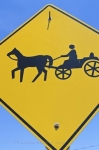 Road warning signs need to be adhered to and this one along the roads in St. Jacobs, Ontario alerts people to be on the look out for horse and buggies.