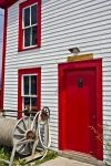 The red and white historic building along the coastline of Woody Point in Newfoundland, Canada is home to the Roberts store.