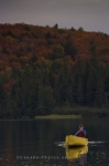 Canoeing on Rock Lake in Algonquin Provincial Park in Ontario, Canada during the Autumn season is very colorful and serene.