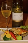 Picture yourself enjoying this gourmet meal of salmon cooked on a hot rock accompanied by a glass or two of white wine.