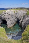 Amongst the rock formations are two entrances to sea caves in Dungeon Provincial Park, Cape Bonavista in Newfoundland, Canada.