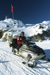 A Ski Patrol on snowmobile on Whistler Mountain in winter, Whistler, British Columbia, Canada, North America.