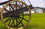 Photo of spoke wheels of a Red River cart with tires made of shaganappi (rawhide) on display at Fort Walsh National Historic Site, Cypress Hills Interprovincial Park, Saskatchewan, Canada.