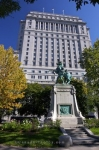The Sun Life Building towers over a monument in Square Dorchester in Centre Ville in Montreal, Quebec in Canada.