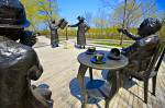 Photo of statues of the Famous Five (women) entitled Women are Persons! in the grounds of Parliament Hill, City of Ottawa, Ontario, Canada.
