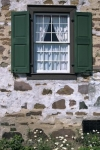 A window on an old stone house in Sault Ste Marie in Ontario, Canada.