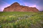 A glorious sunset over Castle Butte heralds the day's end in the Big Muddy Badlands of Saskatachewan, a scenic area steeped in history and natural beauty.