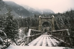 Remembering the goldrush on the Alexandra Suspension Bridge near Yale in British Columbia displaying a winter wonderland.