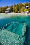 Below the surface of the turquoise colored water of Lake Huron, the remains of the Sweepstakes shipwreck is easily viewed in Big Tub Harbour in Fathom Five National Marine Park in Ontario, Canada.